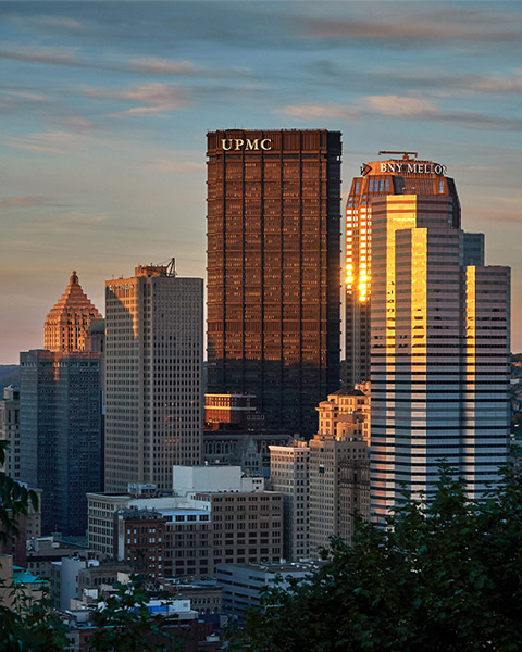 Tall buildings in the Pittsburgh skyline at sunset..