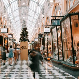 A shopping mall with checkered floors is decorated for Christmas