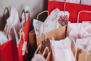 Red and brown gift bags stuffed with tissue paper